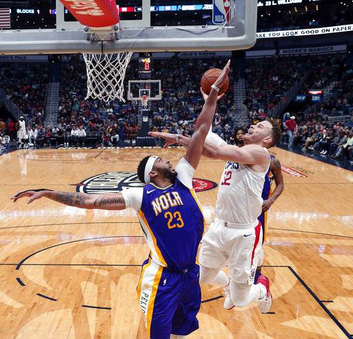 Los Angeles Clippers forward Blake Griffin (32) shoots against New Orleans Pelicans forward Anthony Davis (23) in the second half of an NBA basketball game in New Orleans, Sunday, Jan. 28, 2018. The Clippers won 112-103.