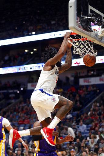 Los Angeles Clippers center DeAndre Jordan slam-dunks in the first half of an NBA basketball game against the New Orleans Pelicans in New Orleans, Sunday, Jan. 28, 2018.