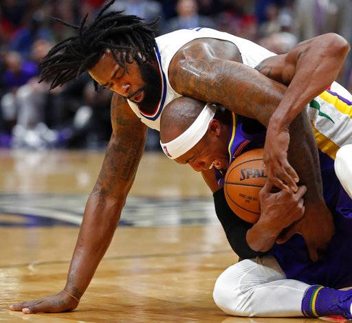 New Orleans Pelicans forward Dante Cunningham, bottom, and Los Angeles Clippers center DeAndre Jordan, top, battle for the ball in the first half of an NBA basketball game in New Orleans, Sunday, Jan. 28, 2018.