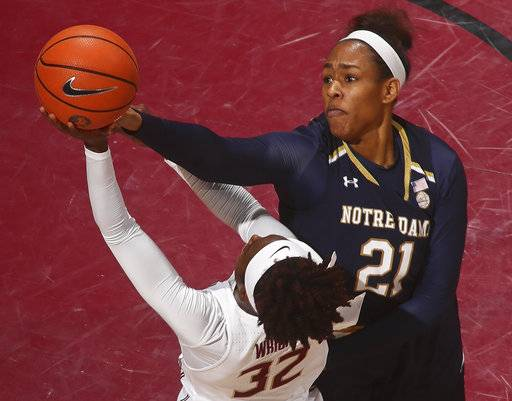 Notre Dame forward Kristina Nelson (21) blocks a shot by Florida State guard Imani Wright (32) in the first quarter of an NCAA college basketball game Sunday, Jan. 28, 2018, in Tallahassee, Fla.