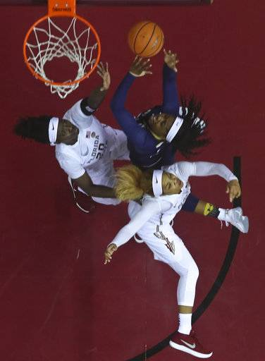 Notre Dame guard Arike Ogunbowale (24) goes for a layup against Florida State forward Shakayla Thomas (20) and guard AJ Alix, bottom, in an NCAA college basketball game against Sunday, Jan. 28, 2018, in Tallahassee, Fla.