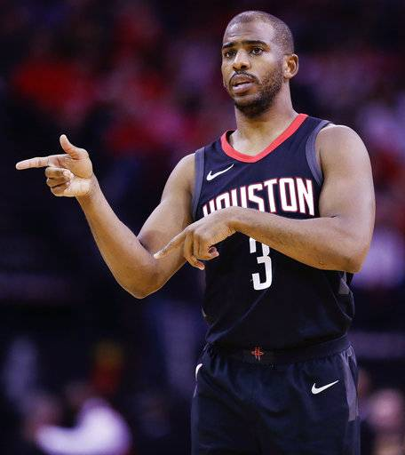Houston Rockets guard Chris Paul gives instructions during the first half of an NBA basketball game against the Phoenix Suns, Sunday, Jan. 28, 2018, in Houston.