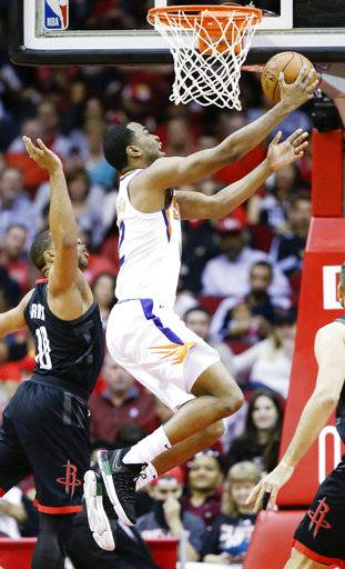 Phoenix Suns forward TJ Warren, right, drives to the basket as Houston Rockets guard Eric Gordon defends during the first half of an NBA basketball game, Sunday, Jan. 28, 2018, in Houston.