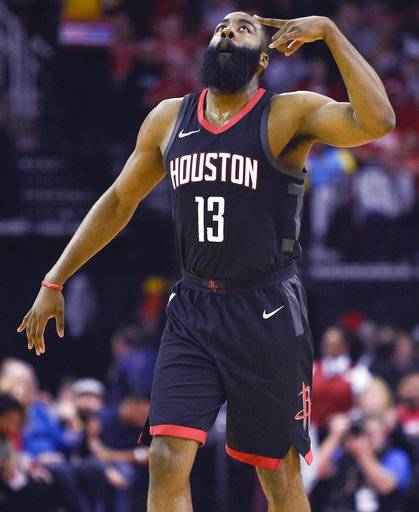 Houston Rockets guard James Harden reacts after making a 3-pointer during the first half of an NBA basketball game against the Phoenix Suns, Sunday, Jan. 28, 2018, in Houston.