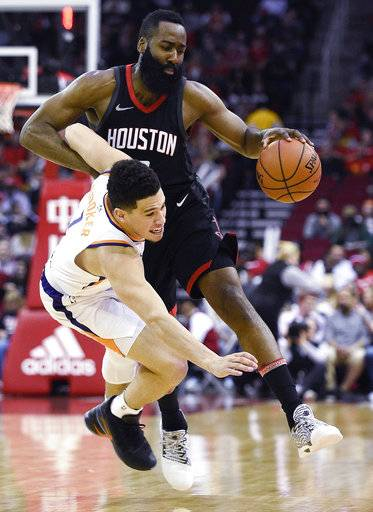 Houston Rockets guard James Harden, right, collides with Phoenix Suns guard Devin Booker during the first half of an NBA basketball game, Sunday, Jan. 28, 2018, in Houston.