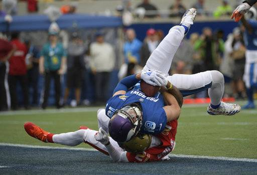 NFC wide receiver Adam Thielen (19), of the Minnesota Vikings, scores a touchdown as AFC defensive back A.J. Buoy (21), of the Jacksonville Jaguars defends, during the first half of the NFL Pro Bowl football game, Sunday, Jan. 28, 2018, in Orlando, Fla.