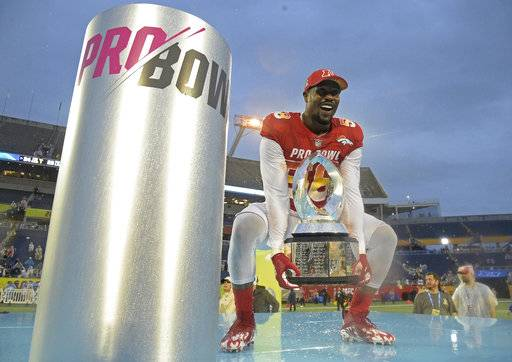 AFC linebacker Von Miller (58), of the Denver Broncos, raises the Pro Bowl trophy after defeating the AFC 24-23, Sunday, Jan. 28, 2018, in Orlando, Fla. Miller won the MVP for the Defensive Player of the Game.