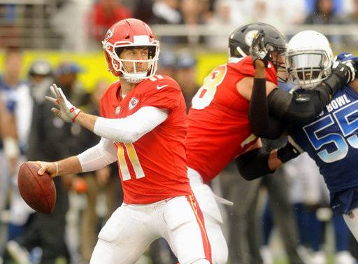 AFC quarterback Alex Smith (11), of the Kansas City Chiefs, looks to pass, during the first half of the NFL Pro Bowl football game against the NFC, Sunday, Jan. 28, 2018, in Orlando, Fla.