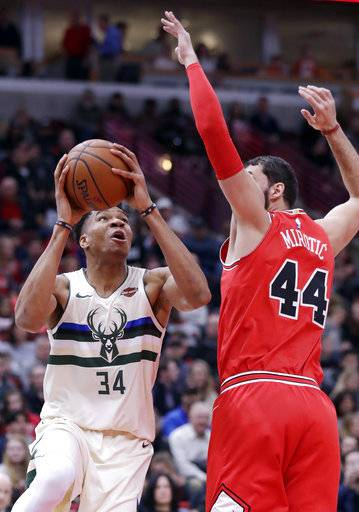 Milwaukee Bucks forward Giannis Antetokounmpo, left, looks to the basket as Chicago Bulls forward Nikola Mirotic guards during the first half of an NBA basketball game Sunday, Jan. 28, 2018, in Chicago.