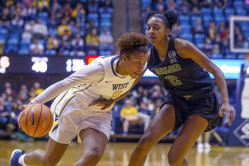 West Virginia's Naomi Davenport, left, drives past Baylor's Didi Richards, right, in the first half of an NCAA college basketball game against Baylor in Morgantown, W.Va., Sunday, Jan. 28, 2018.