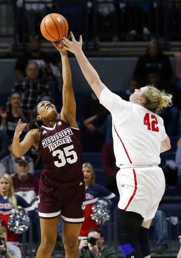 Mississippi State guard Victoria Vivians (35) blocks a shot by Mississippi forward Shelby Gibson (42) during the second half of the NCAA college basketball game in Oxford, Miss., Sunday, Jan. 28, 2018. Mississippi State won 69-49.