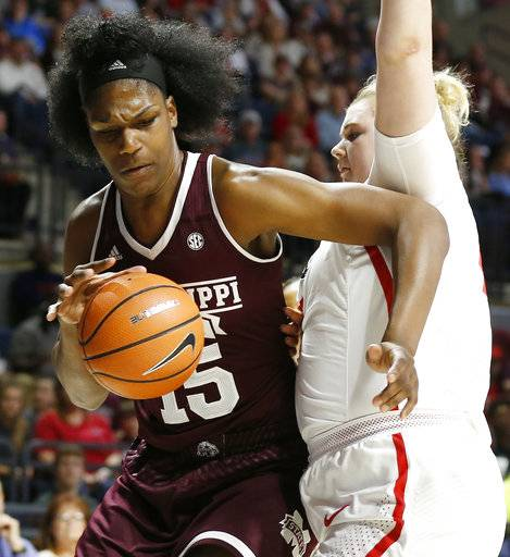 Mississippi State center Teaira McCowan (15) tries to push back against Mississippi forward Shelby Gibson (42) during the first half of the NCAA college basketball game in Oxford, Miss., Sunday, Jan. 28, 2018. Mississippi State won 69-49.