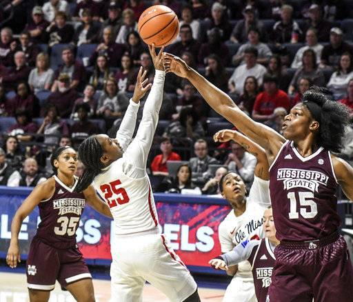 Mississippi State's Teaira McCowan (15) blocks a shot by Mississippi's Alissa Alston (25) in the fourth quarter of an NCAA college basketball game in Oxford, Miss., Sunday, Jan. 28, 2018. (Bruce Newman/The Oxford Eagle via AP)