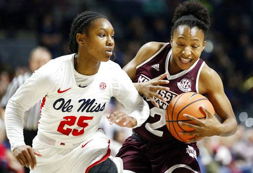 Mississippi guard Alissa Alston (25) fouls Mississippi State guard Morgan William (2) during the first half of an NCAA college basketball game in Oxford, Miss., Sunday, Jan. 28, 2018.