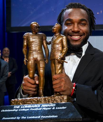 Stanford running back Bryce Love poses for photos with the Lombardi Award trophy at the Lone Star College Cy Fair on Saturday, Jan. 27, 2018, in Cypress, Texas. (Brett Coomer/Houston Chronicle via AP)