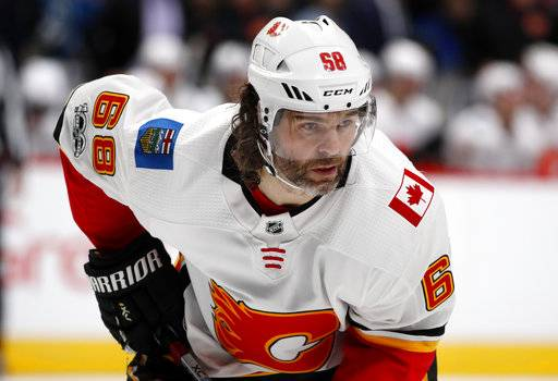 FILE - In this Nov. 25, 2017, file photo, Calgary Flames right wing Jaromir Jagr, of the Czech Republic, waits for a face-off against the Colorado Avalanche during the second period of an NHL hockey game in Denver. Multiple people with direct knowledge of the move say the Calgary Flames have placed Jagr on waivers. The people spoke to The Associated Press on condition of anonymity Sunday, Jan. 28, 2018, because the team had not announced the transaction.
