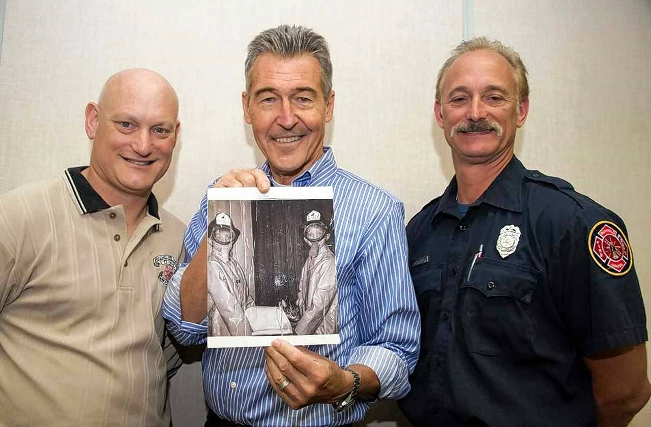 "Buffalo Grove firefighter/paramedic Kevin Hauber, left, and his twin brother Jim, right, were inspired to become firefighters by the 1970s television show ""Emergency!"" In 2014, they met Randy Mantooth, one of the show's stars, who signed a photo of the two young brothers dressed as firefighters."