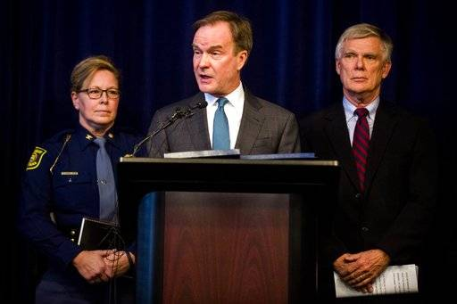 Attorney General Bill Schuette announces an open and ongoing investigation into the systemic issues with sexual misconduct at Michigan State University that began in 2017 on Saturday, Jan. 27, 2018 at the G. Mennen Williams Building in Lansing, Mich.  Schuette said  that the independent probe will shine a bright light on every corner of the university.    (Jake May/The Flint Journal-MLive.com via AP)