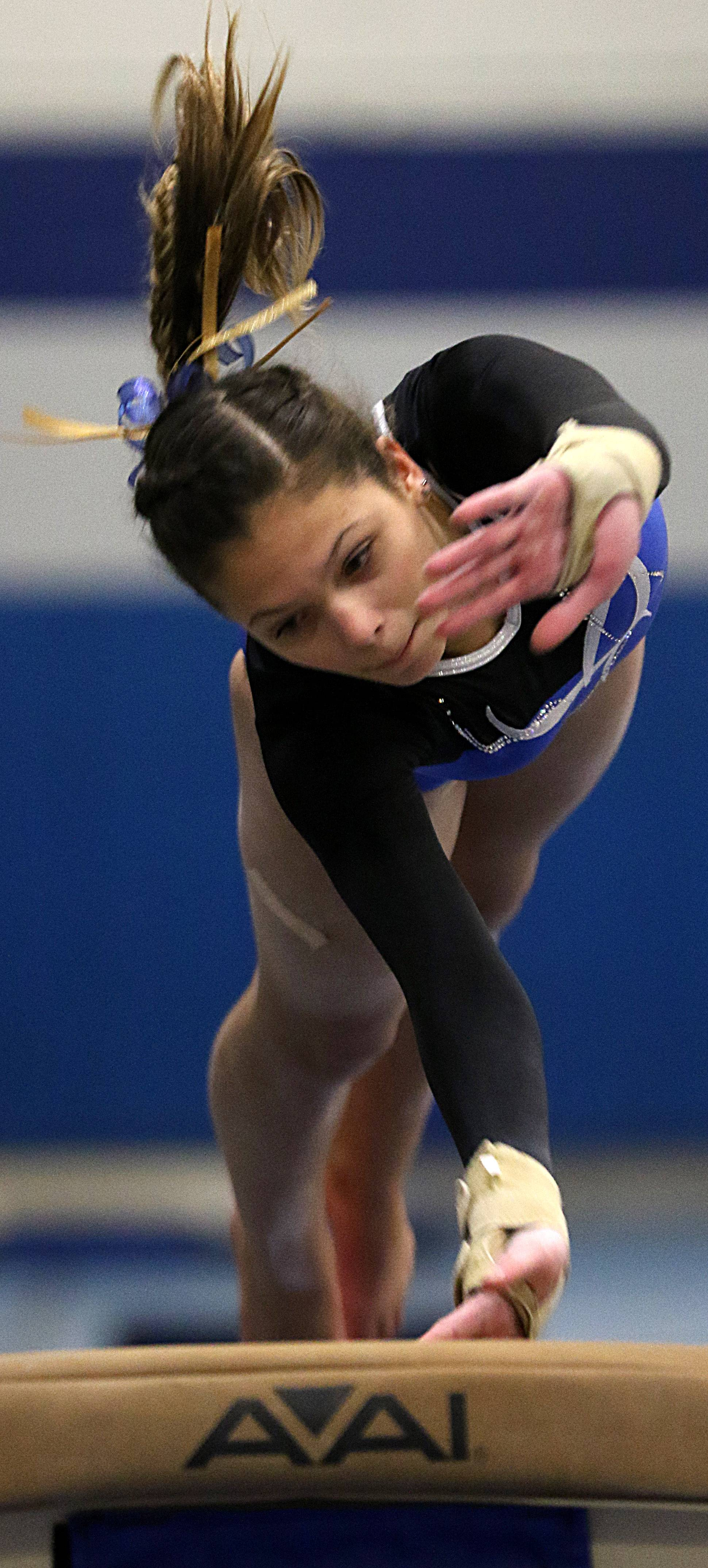 Wheeling's Emily Zajac performs on the vault during regional gymnastics action at Wheeling on Monday evening.