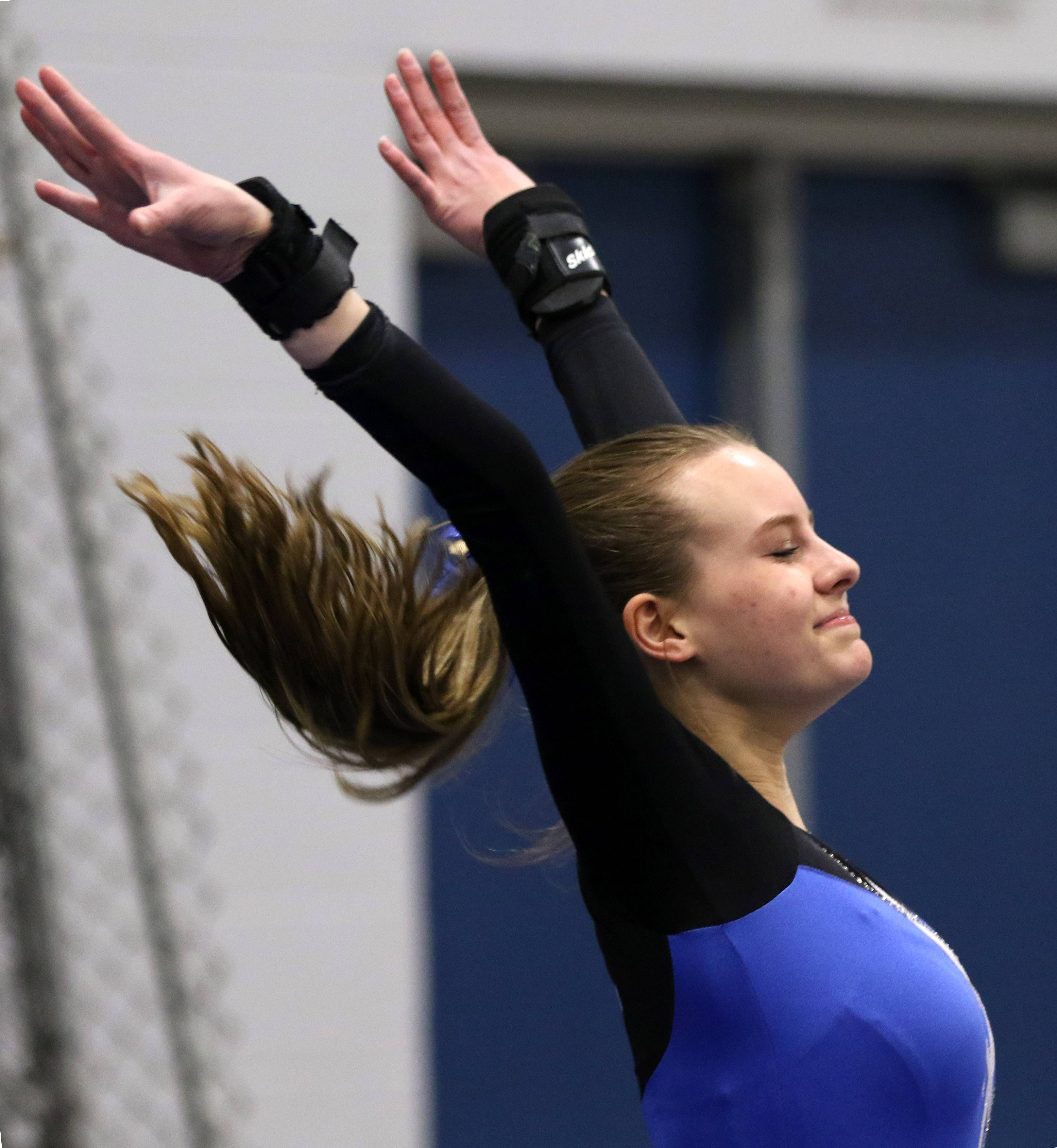 Wheeling's Jessica Stavros completes her vault during regional gymnastics action at Wheeling on Monday evening.