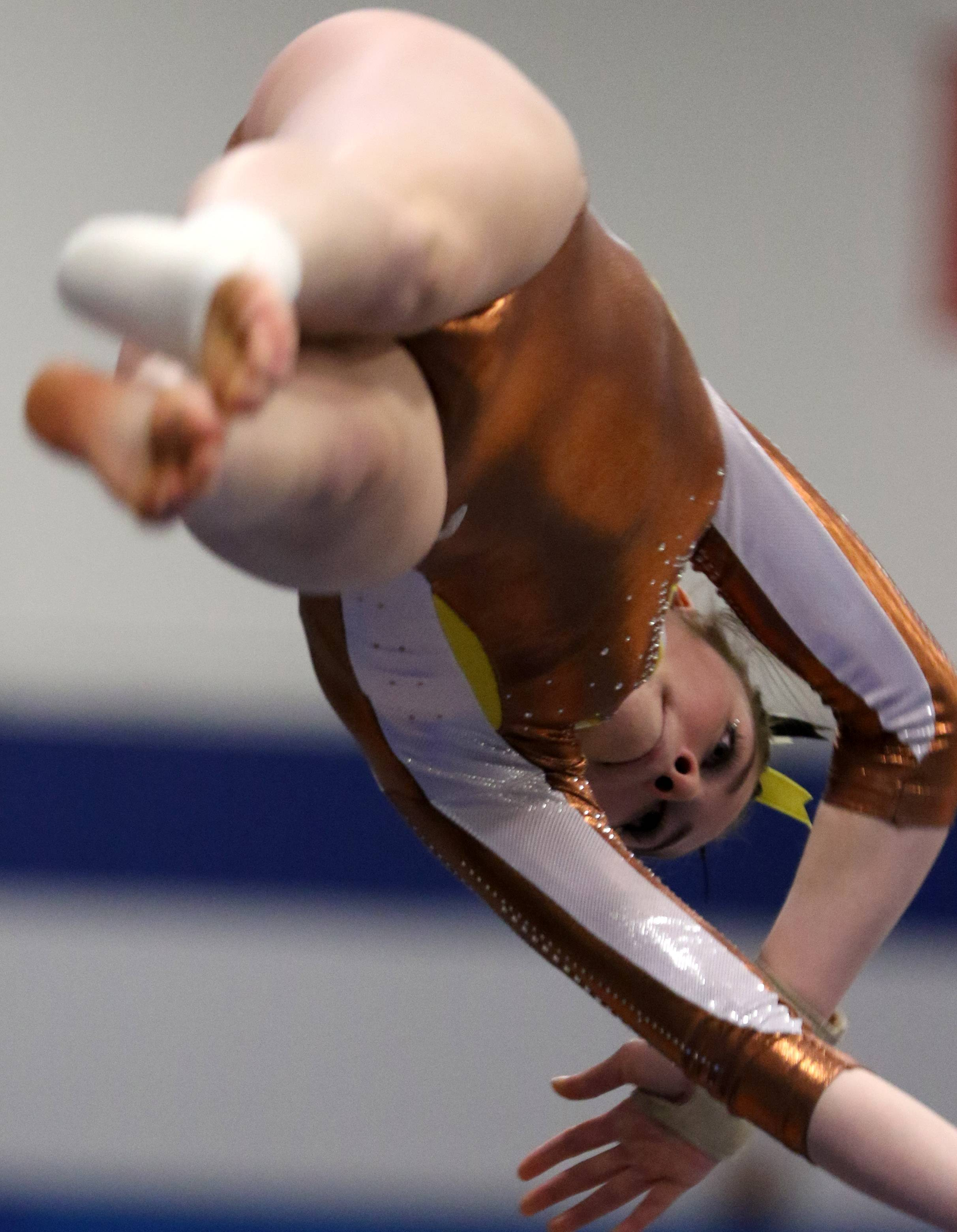Carmel's Audrey Legarreta performs on the vault during regional gymnastics action at Wheeling on Monday evening.