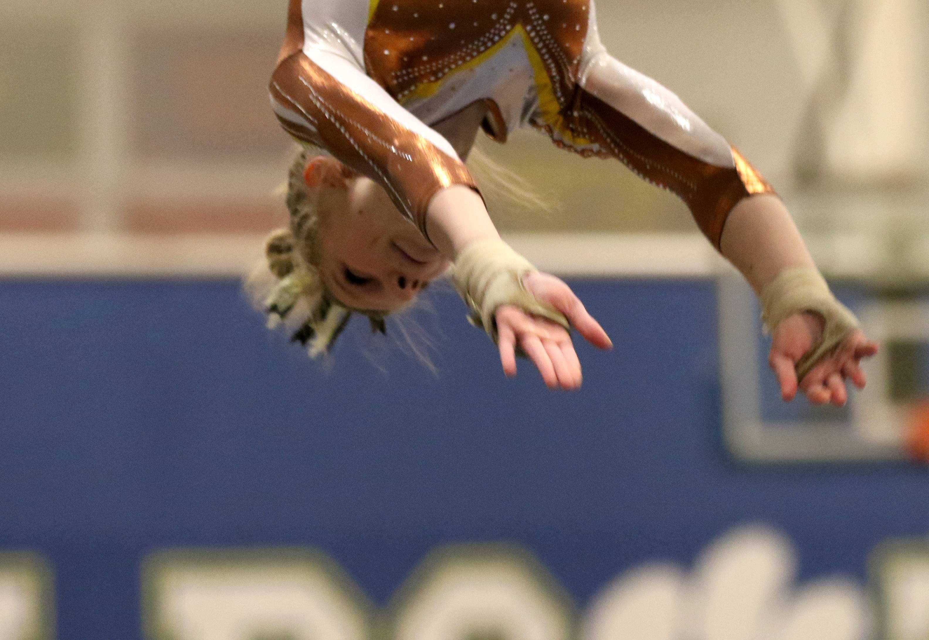 Carmel's Lyndsey Basara performs on the vault during regional gymnastics action at Wheeling on Monday evening.