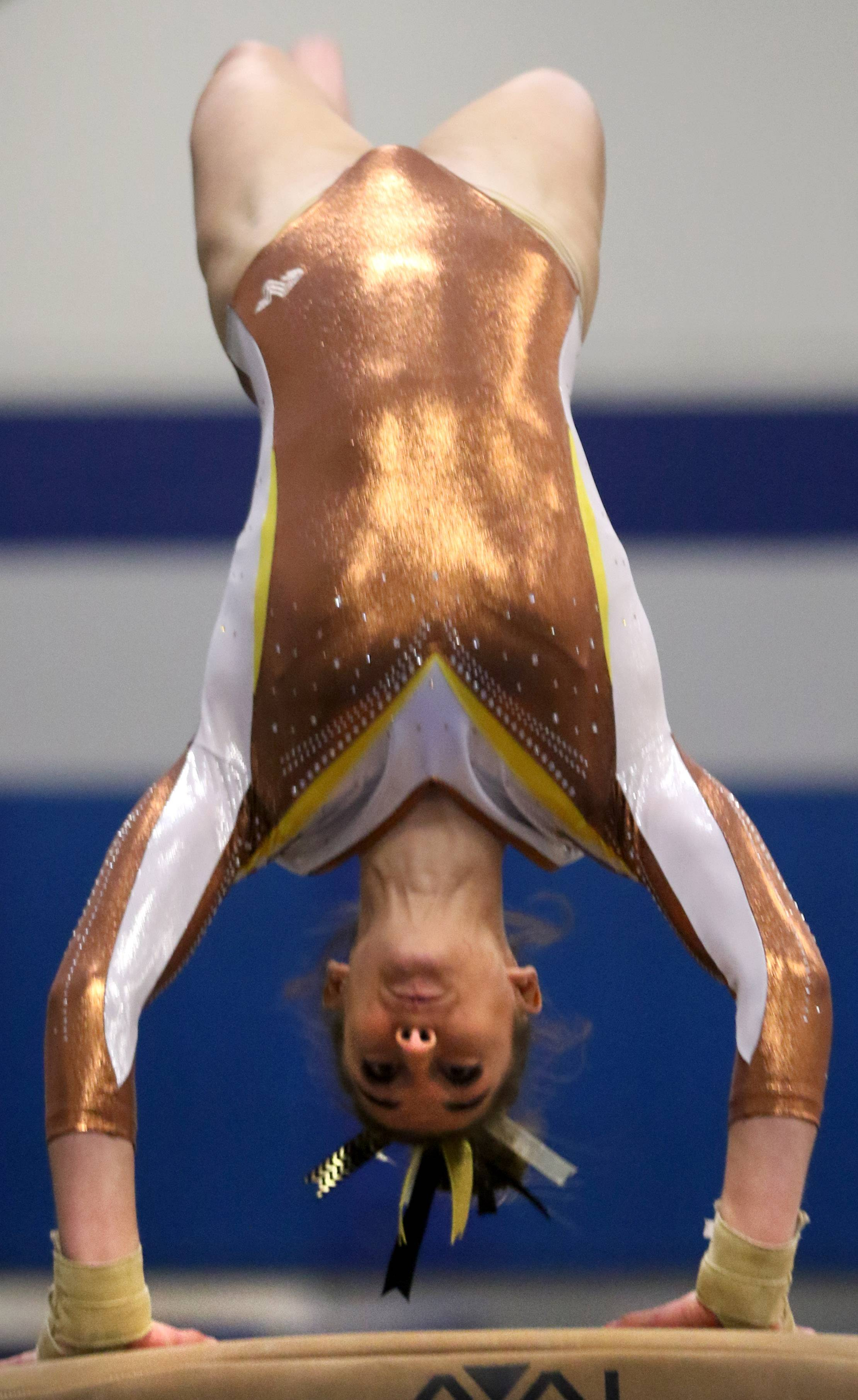 Carmel's Isabella Kropiwiec performs on the vault during regional gymnastics action at Wheeling on Monday evening.