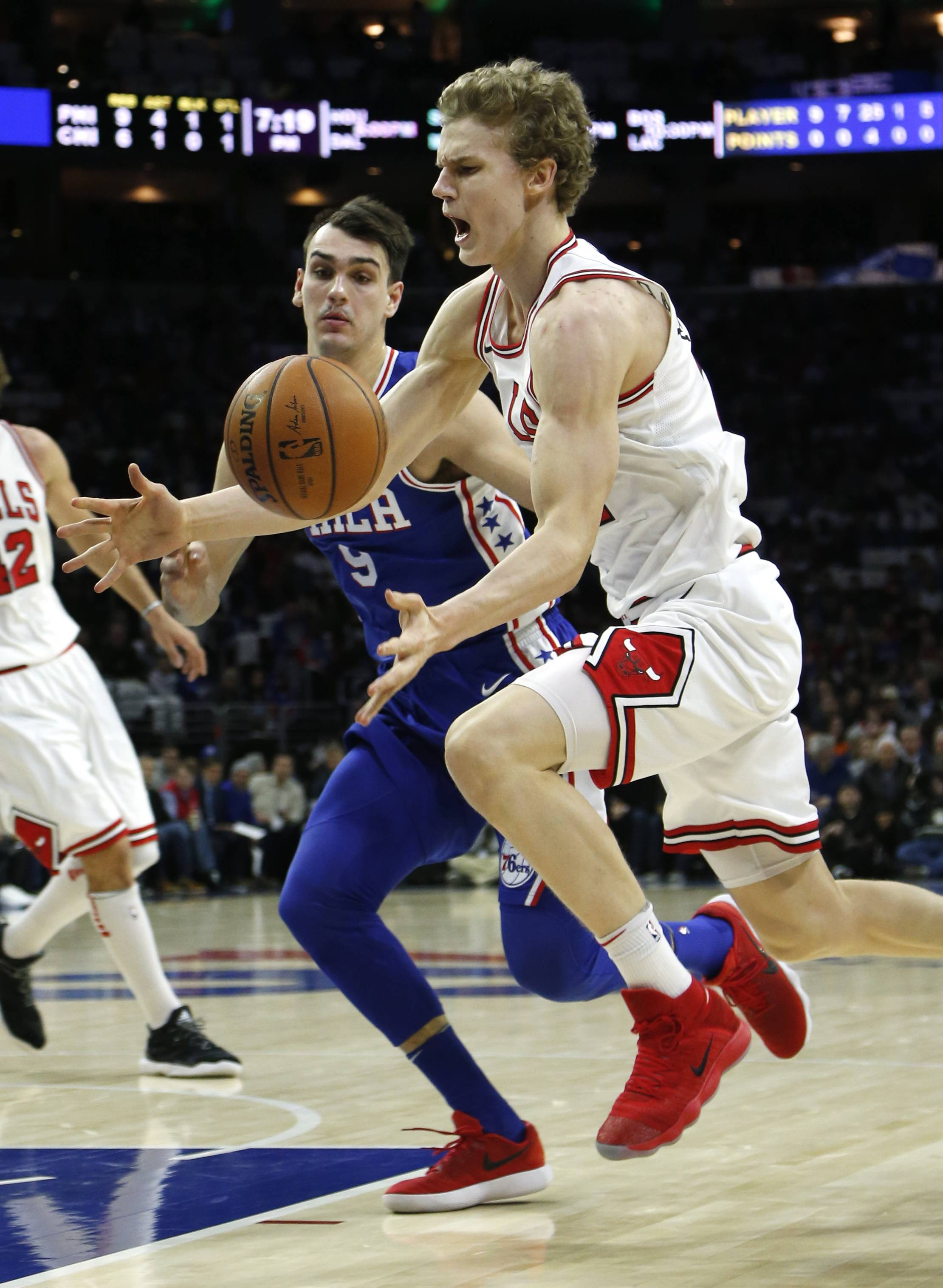 Chicago Bulls forward Lauri Markkanen, right, is fouled by Philadelphia 76ers forward Dario Saric (9) during the first half on an NBA basketball game Wednesday, Jan. 24, 2018, in Philadelphia. Markkanen offensive production has dropped from 19.3 points per game to 14.6 with starting point guard Kris Dunn sidelined with a concussion.