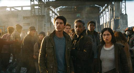 "FILE - This undated image released by Twentieth Century Fox shows, foreground from left, Dylan O'Brien, Giancarlo Esposito and Rosa Salazar in a scene from ""Maze Runner: The Death Cure."" ""Maze Runner: The Death Cure� is the highest grossing film of the weekend, but according to studio estimates Sunday, Jan. 28, 2018, many moviegoers also chose the first weekend after Oscar nominations to catch up with some awards contenders like ""The Shape of Water, "" which got a 161 percent boost in its ninth weekend in theaters. (Twentieth Century Fox via AP, File)"
