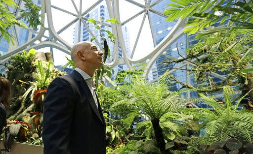 Jeff Bezos, the CEO and founder of Amazon.com, takes a walking tour of the Amazon Spheres, three plant-filed geodesic domes that serve as a work- and gathering place for Amazon employees, following a grand opening ceremony, Monday, Jan. 29, 2018, in Seattle.