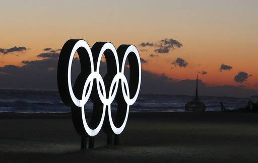 In this Jan. 24, 2018, photo, The Olympic Rings is placed at the beach before sunrise in Gangneung, South Korea. South Korea says North Korea has cancelled one of key joint cooperation projects planned for next month's Winter Olympics in the South.