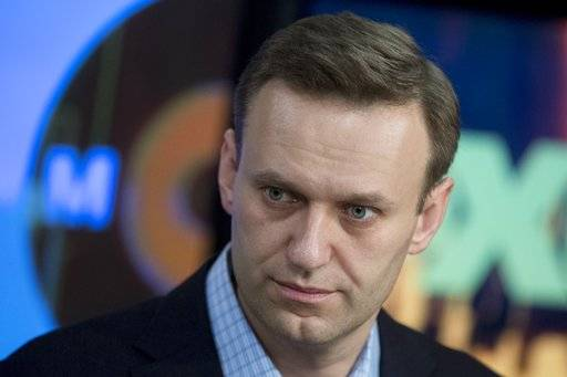 "FILE - In this file photo dated Wednesday, Dec. 27, 2017, Russian opposition activist Alexei Navalny pauses, at the Echo Moskvy (Echo of Moscow) radio station in Moscow, Russia. Russian opposition leader Alexei Navalny has lauded the Trump administration's list of Russian oligarchs and politicians as a ""good list."""