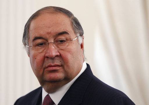 FILE - In this Thursday, Sept. 12, 2013 file photo, Uzbek-born Russian businessman Alisher Usmanov attends a meeting of Russian President Vladimir Putin and Crown Prince Sheik Mohammed bin Zayed Al Nahyan of the United Arab Emirates at the Novo-Ogaryovo state residence outside Moscow. Born in what is now Uzbekistan, Usmanov has interests in metals and mining as well as some of Russia's biggest telecoms and internet businesses. (Maxim Shemetov/Pool Photo via AP, File)