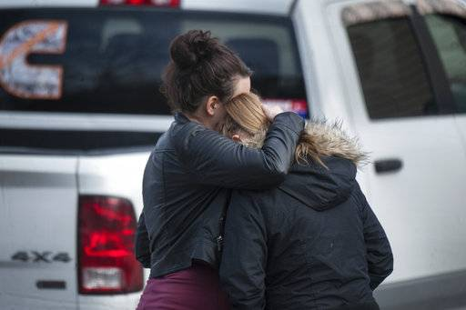 A woman comforts Jenna Porterfield, right, after a deadly shooting Sunday, Jan. 28, 2018, in Saltlick Township, Pa. State police said Timothy Smith opened fire early Sunday morning at Ed's Car Wash, killing several. (Stephanie Strasburg/Pittsburgh Post-Gazette via AP)