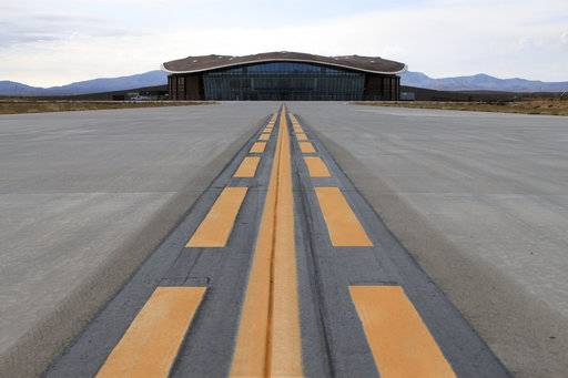 FILE - This Dec. 9, 2014, file photo shows the taxiway leading to the hangar at Spaceport America in Upham, N.M. Operators of the New Mexico Spaceport Authority that runs Spaceport America in southern New Mexico are seeking greater confidentiality for tenants that include aspiring commercial spaceflight company Virgin Galactic.