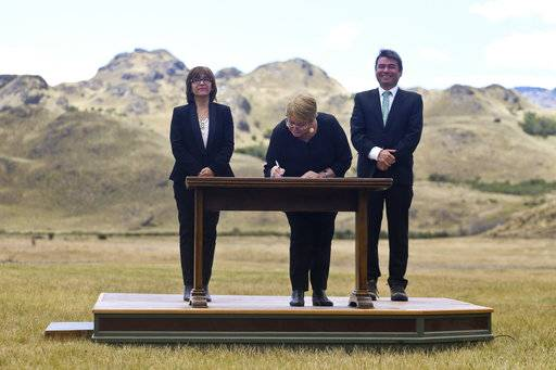 Chilean President Michelle Bachelet signs decrees creating vast new national parks using lands donated by the Tompkins Conservation, in what is believed to be the largest private donation of land ever from a private entity to a country, at a ceremony in Patagonia Park, Chile, Monday, Jan. 29, 2018.