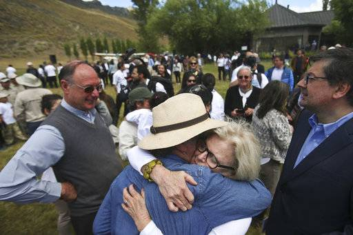 Kristine McDivitt Tompkins, widow of late American conservationist Doug Tompkins, embraces a friend at the end of a signing ceremony in Patagonia Park, Chile, Monday, Jan. 29, 2018. Chile's president signed decrees creating vast new national parks using lands donated by the Tompkins Conservation, in what is believed to be the largest private donation of land ever from a private entity to a country.