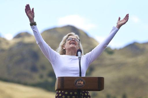 Kristine McDivitt Tompkins, widow of late American conservationist Doug Tompkins raises her arms as she speaks during a signing ceremony in Patagonia Park, Chile, Monday, Jan. 29, 2018. Chile's president signed decrees creating vast new national parks using lands donated by the Tompkins Conservation, in what is believed to be the largest private donation of land ever from a private entity to a country.