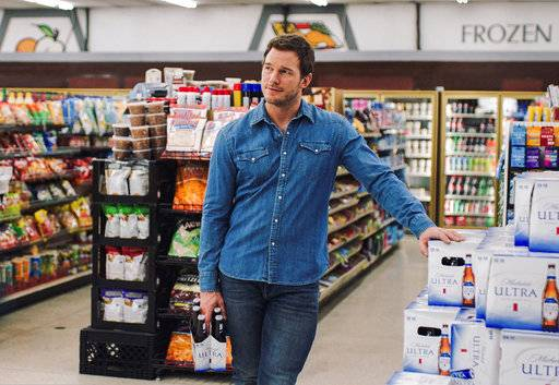 "This image released by Anheuser-Busch shows actor Chris Pratt in a scene from a Michelob Ultra commercial. Pratt, the star of the ""Jurassic World� and ""Guardians of the Galaxy� film franchises, will make his advertising debut Super Bowl Sunday in a pair of commercials for the light beer. (Anheuser-Busch via AP)"