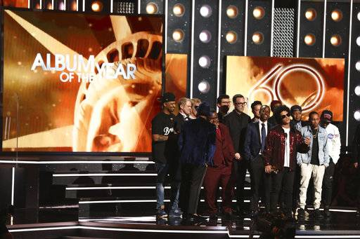 "Bruno Mars, front center, accepts the award for album of the year for ""24K Magic"" at the 60th annual Grammy Awards at Madison Square Garden on Sunday, Jan. 28, 2018, in New York. (Photo by Matt Sayles/Invision/AP)"