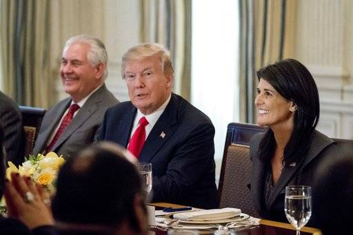 President Donald Trump, accompanied by Secretary of State Rex Tillerson, left, and U.S. Ambassador to the UN Nikki Haley, right, has lunch with the United Nations Security Council in the State Dining Room at the White House, Monday, Jan. 29, 2018, in Washington.