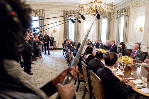 President Donald Trump, third from right, accompanied by Secretary of State Rex Tillerson, fourth from right, U.S. Ambassador to the UN Nikki Haley, second from right, and National Security Adviser H.R. McMaster, right, speaks during a lunch with the United Nations Security Council in the State Dining Room at the White House, Monday, Jan. 29, 2018, in Washington.