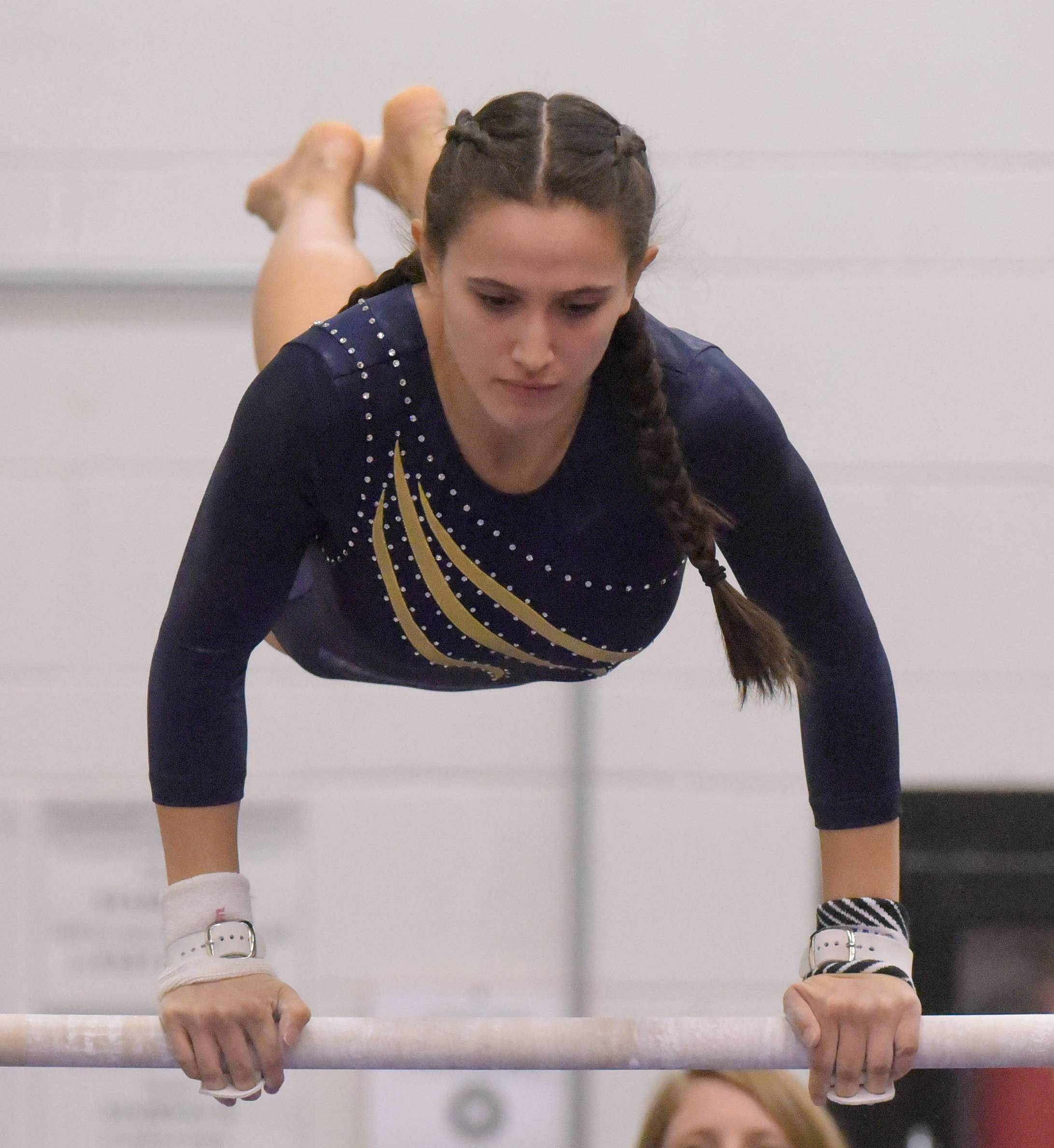 Leyden's Esther Aldana competes on the bars during the Glenbard East girls gymnastics regional on Monday, Jan. 29, 2018.
