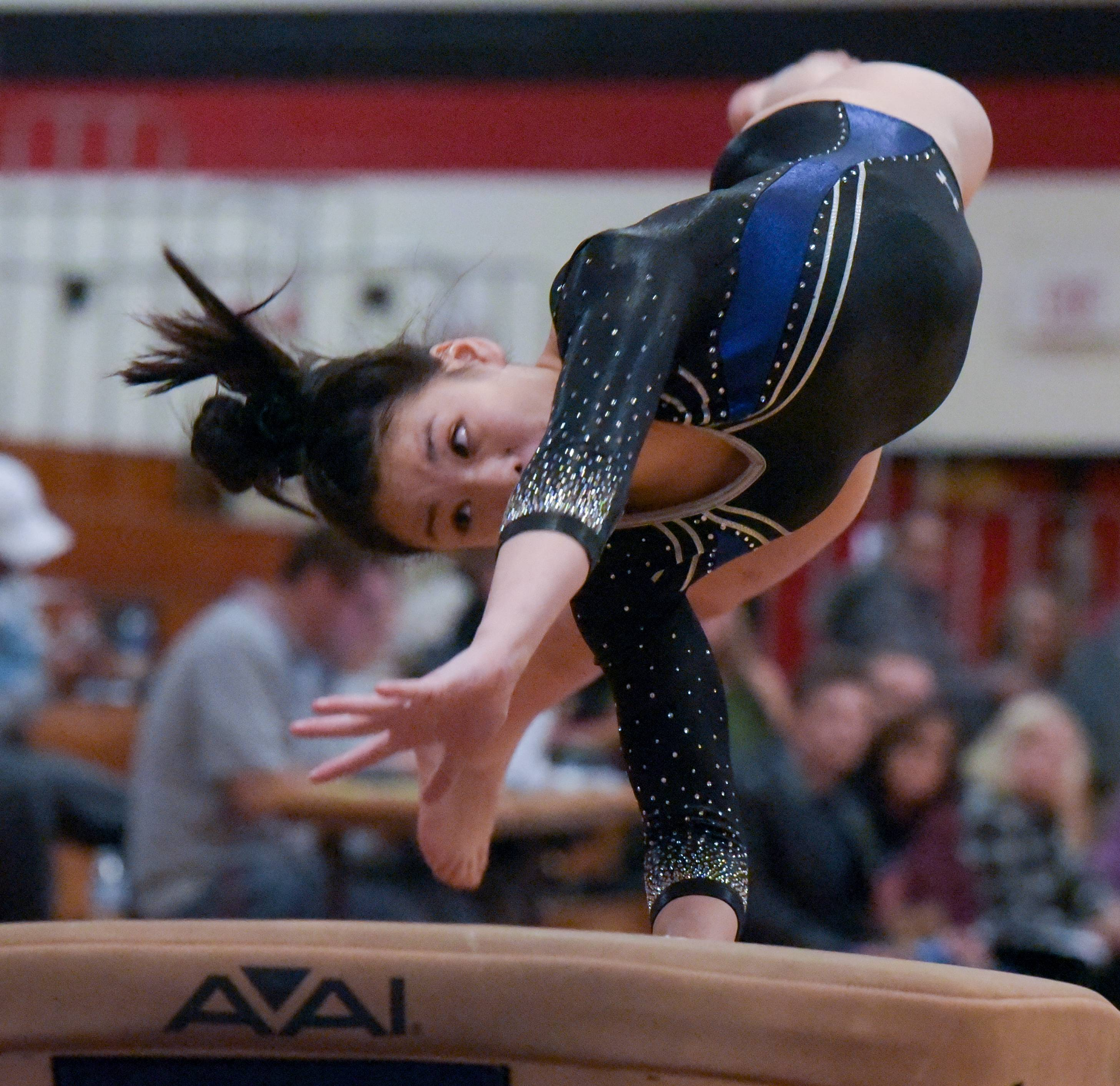 St. Charles' Emma Gracew Redmond-Mattucci competes on the vault  during the Glenbard East girls gymnastics regional on Monday, Jan. 29, 2018.