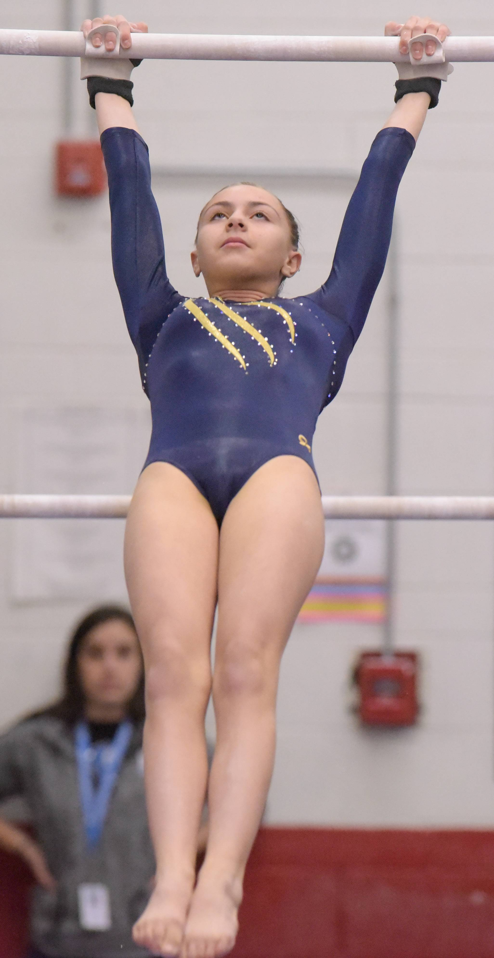 Leyden's Jessica Torres competes on the bars during the Glenbard East girls gymnastics regional on Monday, Jan. 29, 2018.