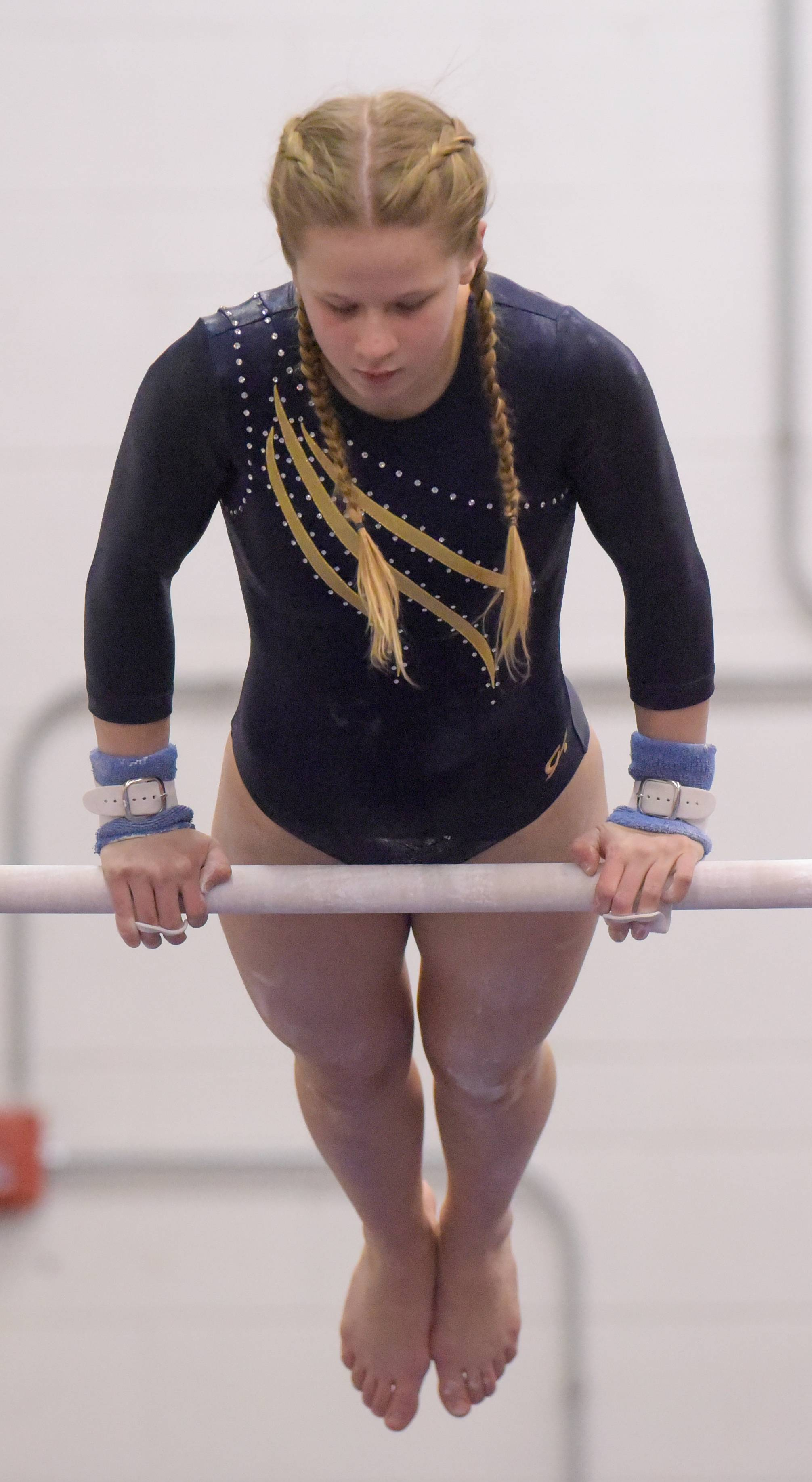 Leyden's Faustyna Karpiesiuk competes on the bars during the Glenbard East girls gymnastics regional on Monday, Jan. 29, 2018.