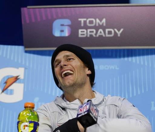 New England Patriots' Tom Brady laughs during NFL football Super Bowl 52 Opening Night Monday, Jan. 29, 2018, at the Xcel Center in St. Paul, Minn.
