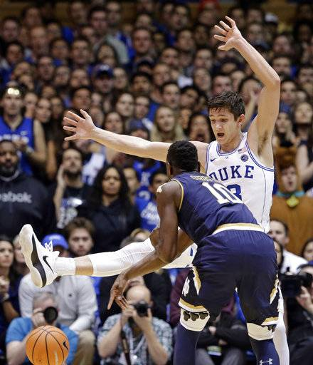 Duke's Grayson Allen defends against Notre Dame's T.J. Gibbs (10) during the first half of an NCAA college basketball game in Durham, N.C., Monday, Jan. 29, 2018.