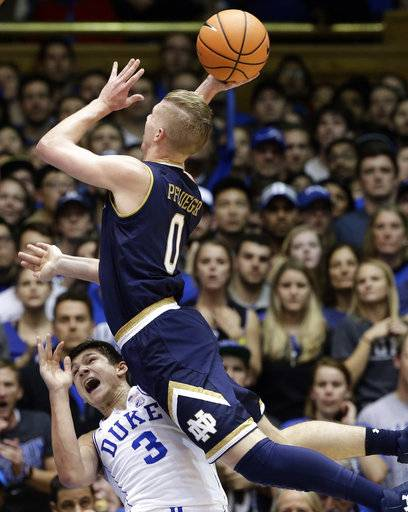 Duke's Grayson Allen (3) draws a charge against Notre Dame's Rex Pflueger (0) during the first half of an NCAA college basketball game in Durham, N.C., Monday, Jan. 29, 2018.