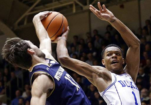 Duke's Trevon Duval (1) looks to pass against Notre Dame's Nikola Djogo (13) during the first half of an NCAA college basketball game in Durham, N.C., Monday, Jan. 29, 2018.